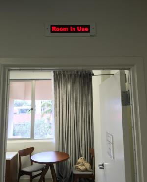 A 'Room in Use' sign can be illuminated from inside the lab