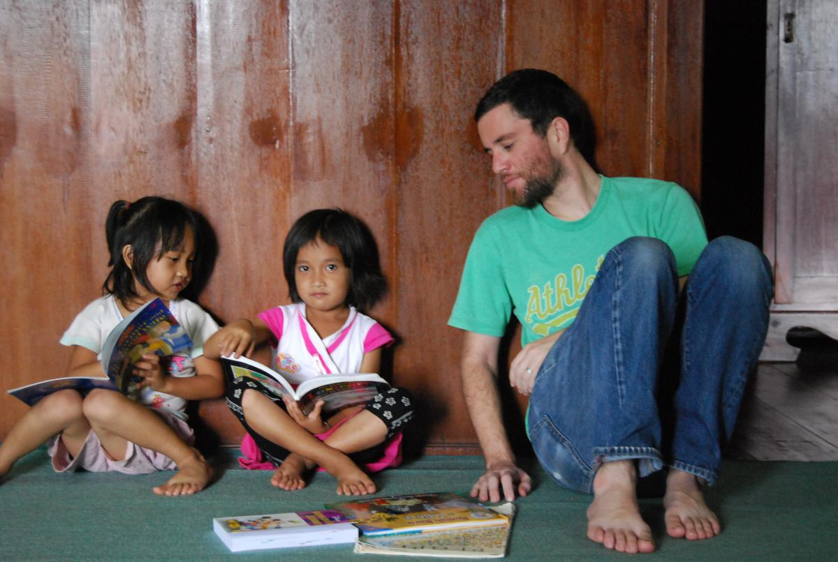 Graduate student Brad McDonnell working with children in Indonesia.